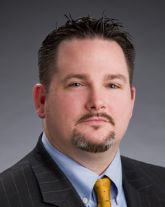 headshot of eric wilson, director of decision management analytics