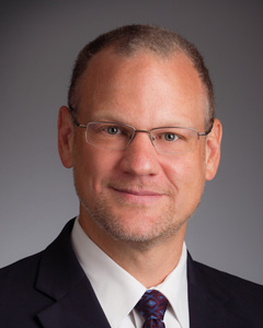 headshot of tony pytlak, president and COO